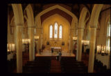 Church Interior with Pews and Altar View