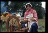 Woman Spinning Yarn on Spinning Wheel